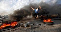 فيديو.. محتجون يستعيدون السيطرة على طريق حيوي جنوبي العراق