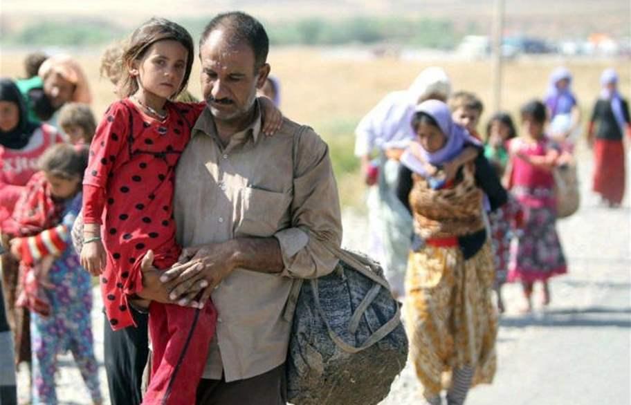 العراق يتسلم لاجئين من سوريا