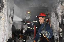 """With the participation of 10 firefighters teams ... a fire put out in an old """"Khan"""" in central Baghdad"""