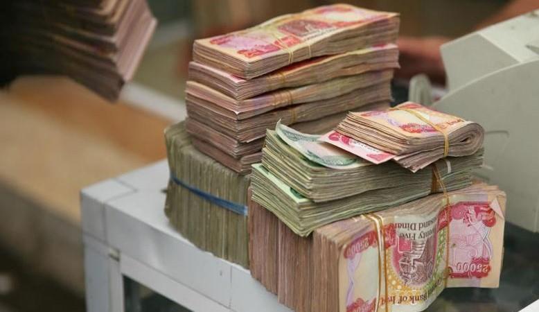 العراق يتخطى أزمة تأمين الرواتب