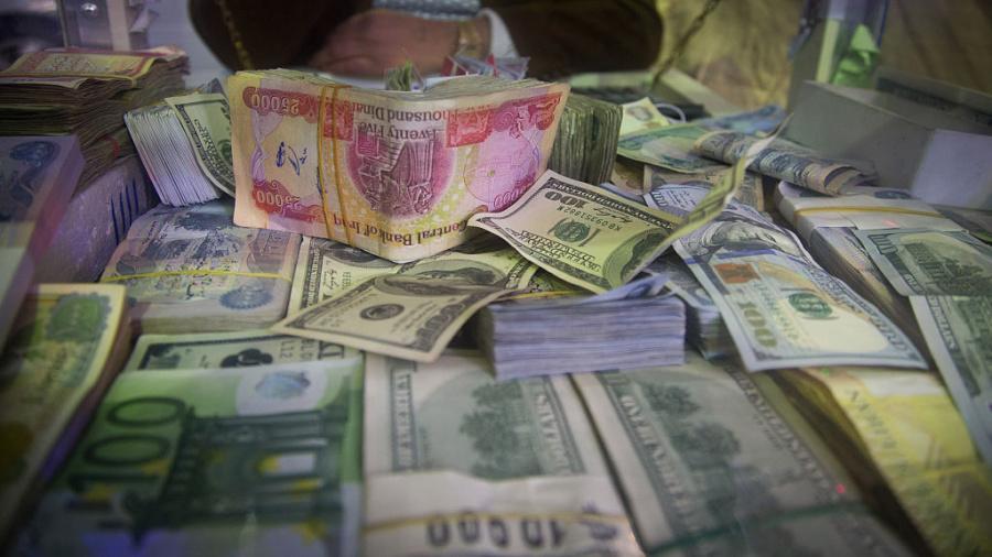 إستقرار اسعار صرف الدولار وانخفاض قيمة الاسهم المتداولة بالعراق