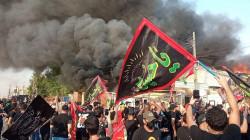 """محتجو """"دجلة"""" يعتدون على الدفاع المدني ويمنعون إخماد النيران"""
