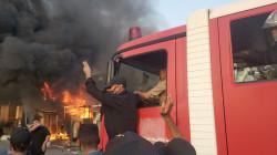 الدفاع المدني ينقذ محتجزين داخل بناية لصياغة الذهب اندلع فيها حريق ببغداد