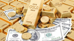 Gold eases as dollar rises