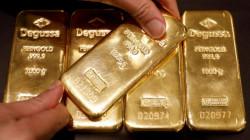 Gold rises as dollar sags; investors eye U.S. stimulus deal