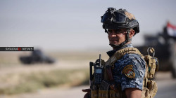 Iraqi Police carry out a security operation in Kirkuk