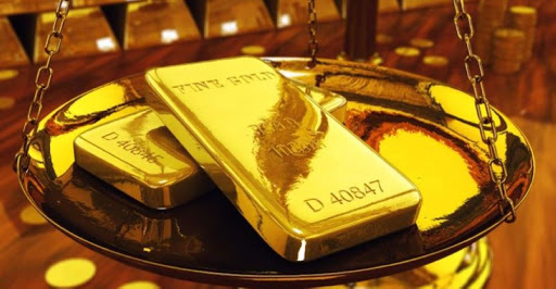 Gold edges up as U.S. dollar retracts