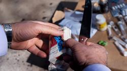 An intelligence team arrest a drug dealer in Najaf