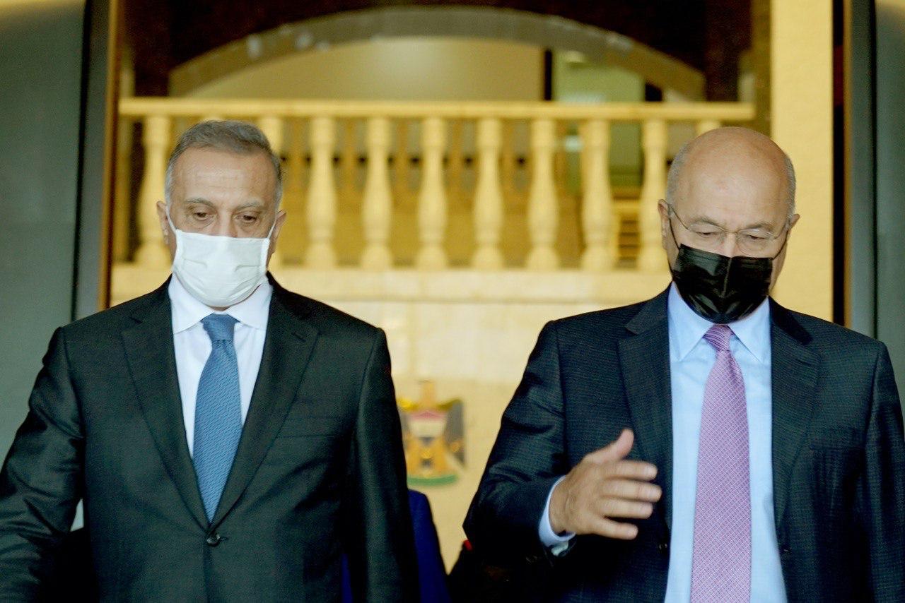"""صالح والكاظمي يبحثان """"السلم الأهلي"""" في العراق"""