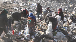 In the shadow of oil rigs, Syrians feed on landfills