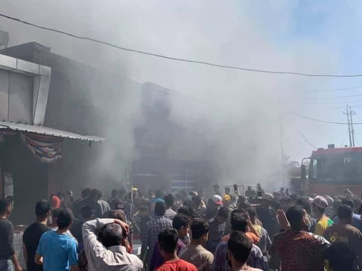 Civil defense teams extinguish a fire in Baghdad