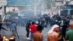 Footage shows clashes between demonstrators and riot police in Najaf