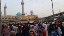 law enforcement break up a demonstration near Najaf governorate headquarters