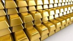 الذهب يتراجع بفعل قوة الدولار