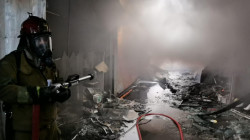 Fifteen civil defense teams put out a massive fire in Baghdad