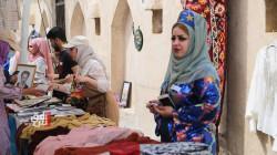 سوق خيري لأعمال فولكلورية صنعت بأيدي النساء في قلعة كركوك (صور)