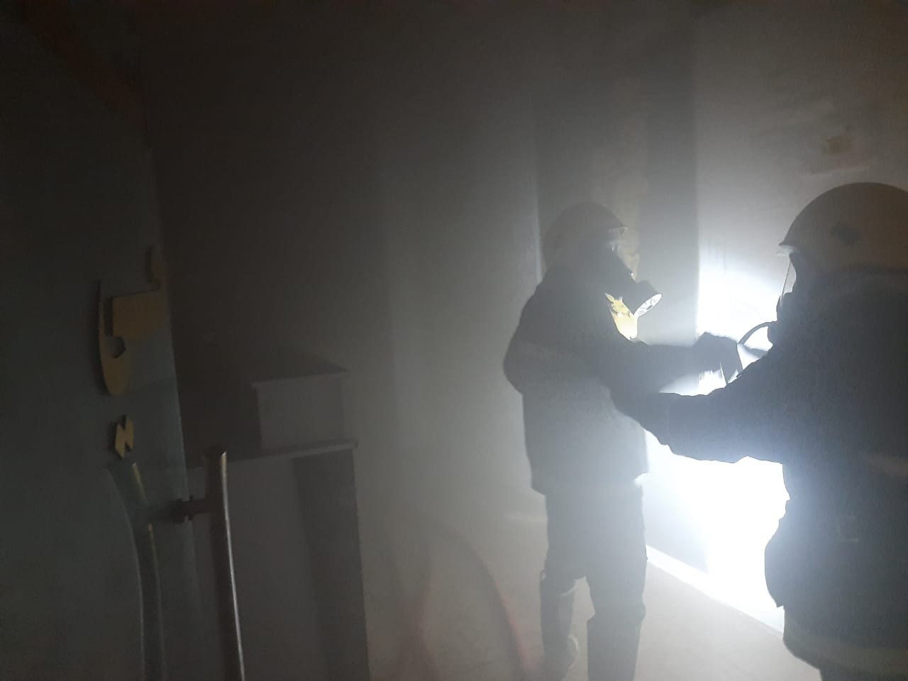 Firefighters extinguish a fire in a hotel in Najaf
