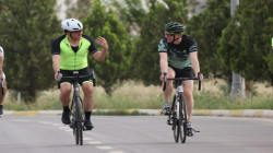 Kurdistan's President and the British ambassador to Iraq, Two cyclists on the road