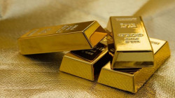 Gold hits 1-week low as yields rise ahead of Fed statement
