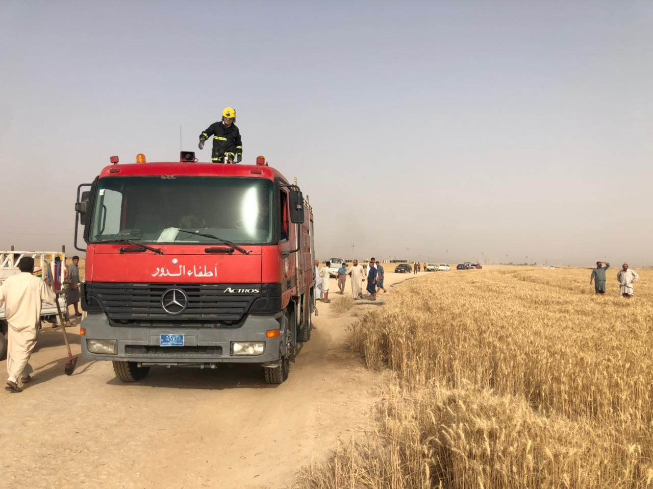 Saving 60 dunums, firefighting teams extinguish a fire in a wheat field in Saladin