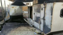Civil Defense teams extinguish the fuel station fire in Baghdad