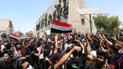 """صور.. """"من قَتلني؟"""" تعيد الاحتجاج الى بغداد"""