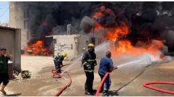 Civil Defense teams extinguish a fire south of Baghdad