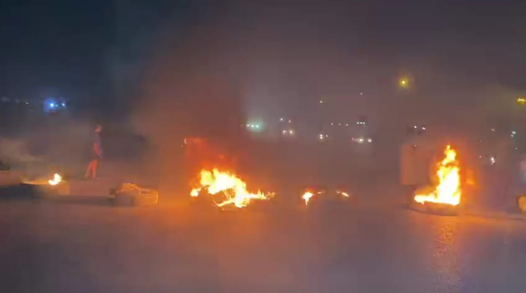Angry demonstrators block a highway in Dhi Qar