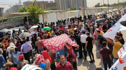 Public servants demonstrate near the Ministry of Electricity headquarters in Baghdad