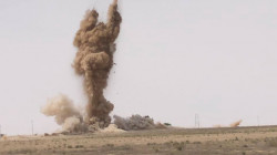An explosion from a roadside bomb hits a coalition convoy in Saladin