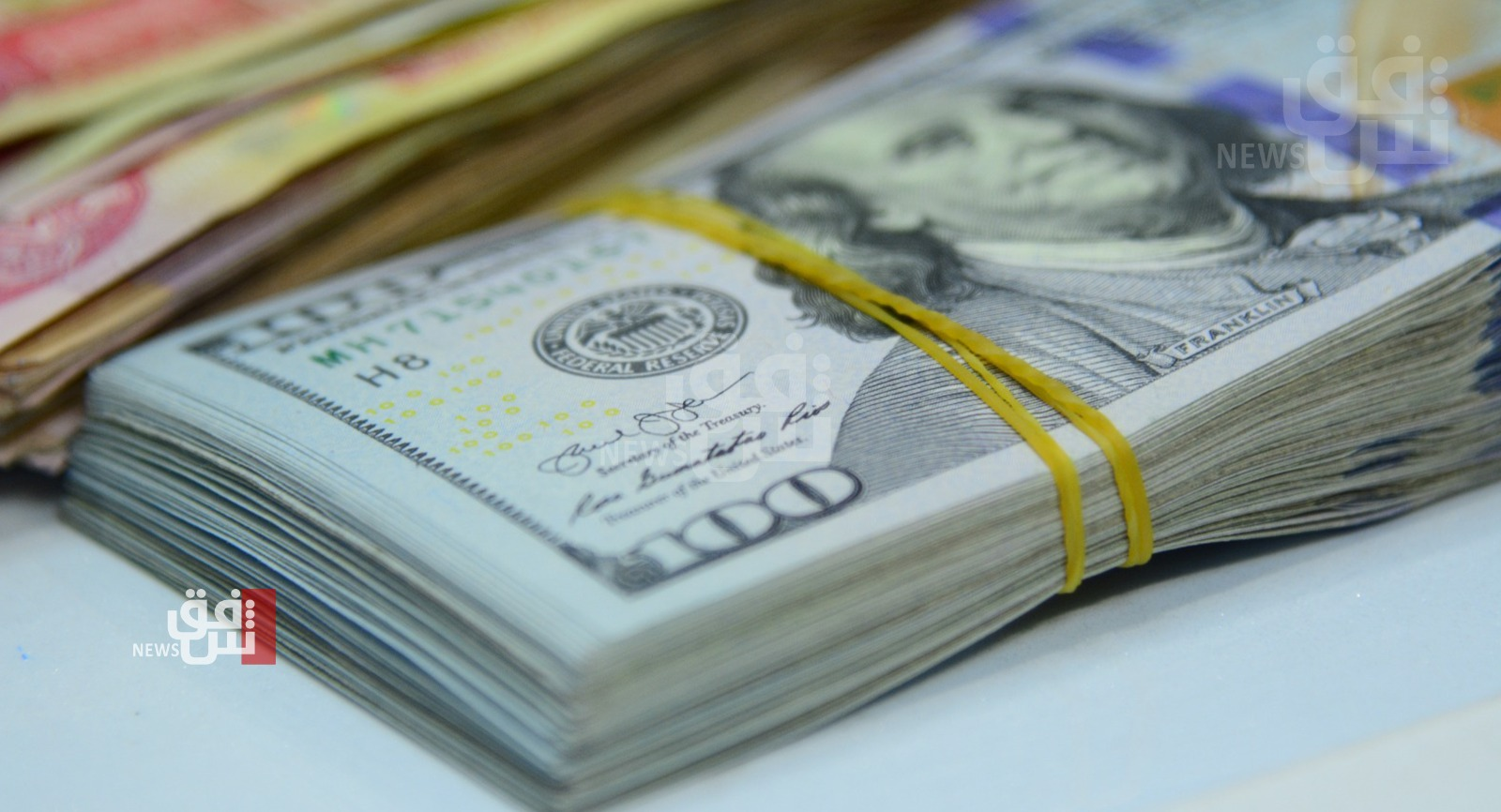 A slight increase in the exchange rates of the dollar in Baghdad and Kurdistan