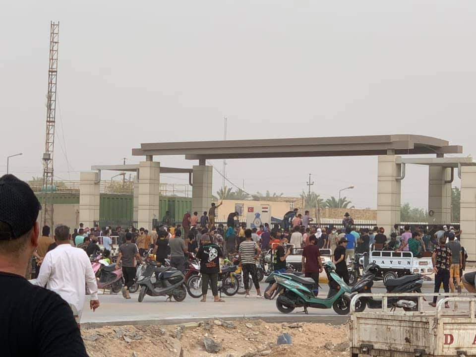 Angry protesters block a main square in the center of Nasiriyah city, Dhi Qar