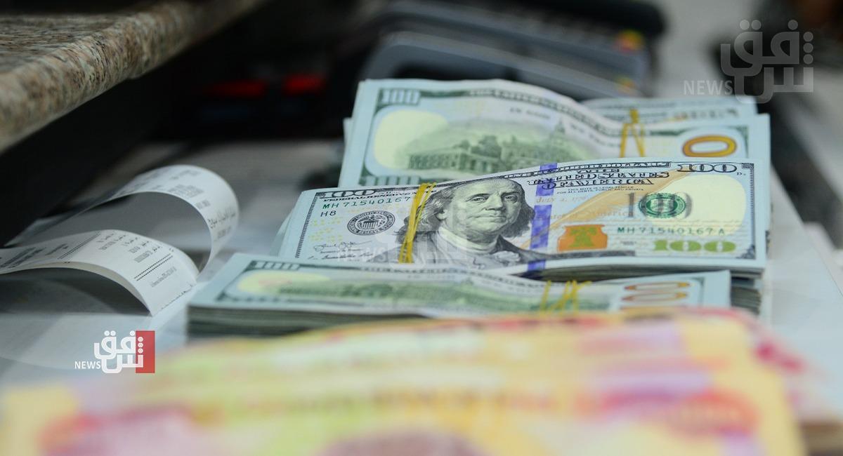 Dollar/Dinar rate drops in Baghdad 1626629326225