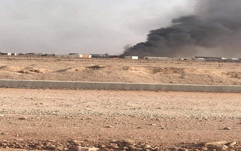 """بعد ساعات من الانفجارات المتواصلة.. إخماد حريق معسكر فرقة """"الإمام علي"""" بالنجف"""