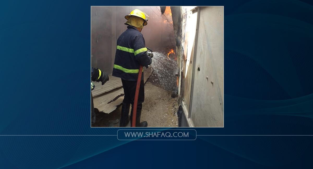 صور.. الدفاع المدني يخمد حريقاً اندلع في سوق بمدينة الصدر