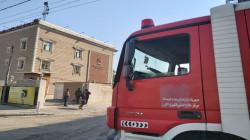 Civil Defense teams extinguish a fire in Bank in Baghdad