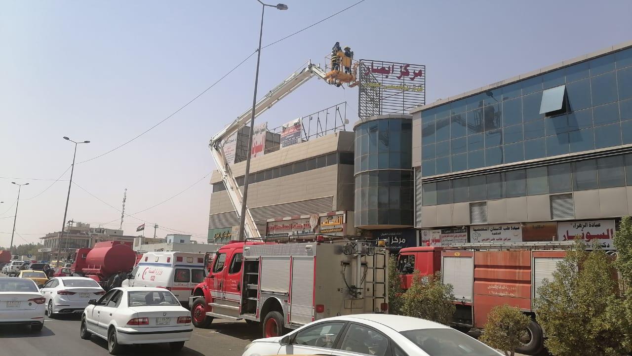 Civil Defense teams extinguish a fire in a medical complex in Najaf