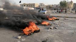 Angry protestors block a main road in Nasiriyah