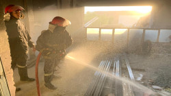 Civil defense teams extinguish a fire in the Doctors' Syndicate in Baghdad
