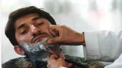 طالبان للحلاقين: حلق اللحى والموسيقى ممنوع