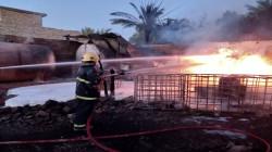 الدفاع المدني يسيطر على حريق خزانات الوقود ببغداد (صور)