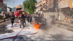 احتراق سيارة تحمل اسطوانات اوكسجين وإصابة سائقها وسط بغداد.. صور