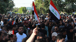With a flower in hand and a sword in the other, Kata'ib Hezbollah calls for escalating protests against the election results