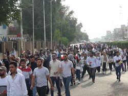 الأمن يستخدم قنابل لفض اعتصامات طلابية في بغداد وكربلاء تعلن حظرا للتجوال