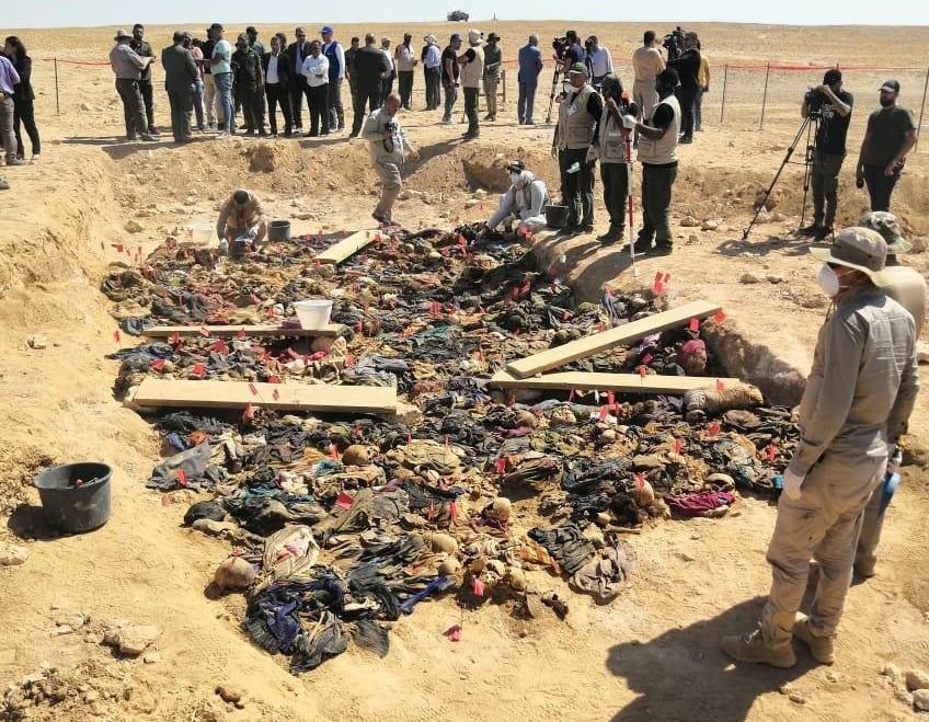 A mass grave of Kurdish women and children opened