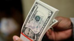 انخفاض سعر الدولار في إيران إلى أقل من 11 ألف تومان