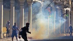 اصابة العشرات باختناقات وانتشار أمني مكثف في جسور بغداد