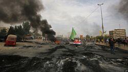 11 قتيلا وجريحا واحتراق همرين عسكريتين باحتجاجات جديدة بالنجف وبغداد