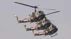 الإعلام الأمني تكشف حجم إصابة مروحية عسكرية في الأنبار
