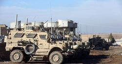 U.S. military trucks enter Iraq from northern Syria